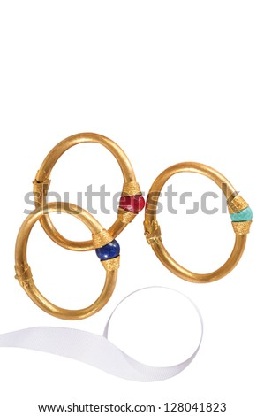 Golden braclets. - stock photo