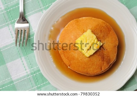 Golden brown pancakes on white plate for healthy breakfast. - stock photo