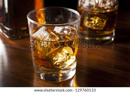Golden Brown Whisky on the rocks in a glass - stock photo