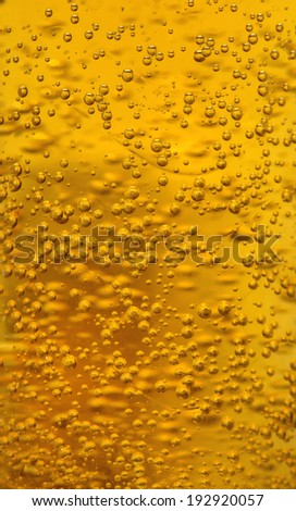 Golden bubbles of beer texture, for background. - stock photo