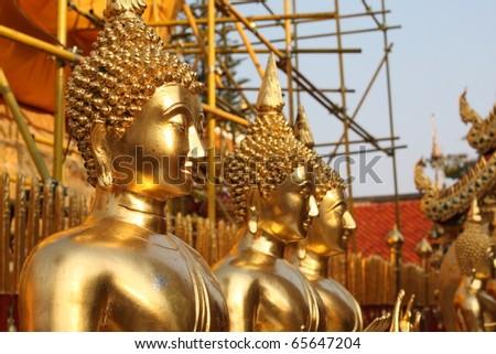 golden buddah statue at a temple in bangkok - stock photo