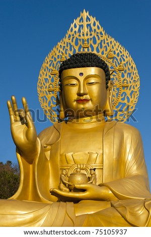 Golden Buddha statue at buddhist temple of Sanbanggulsa at Sanbangsan of Jeju island Korea - stock photo