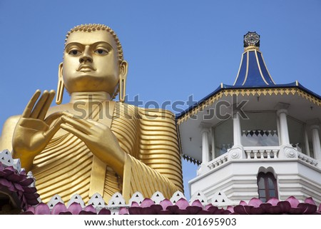 Golden Buddha Statue In Front Of The Entrance To Dambulla Cave Temple, Outdoor - stock photo