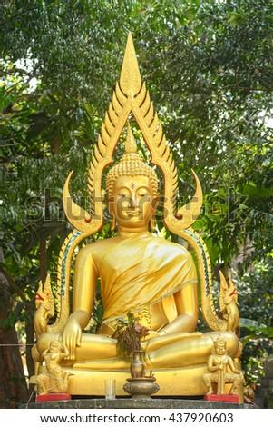 golden Buddha statue in Thailand - stock photo