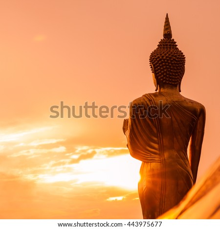 Golden Buddha statue standing on a mountain at  Wat Phra That Khao Noi, Nan Province, Thailand - stock photo