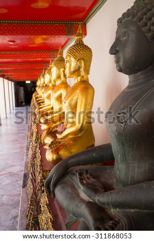 Golden Buddha statues in Wat Pho Temple - Buddhist temple complex in Bangkok, Thailand - stock photo
