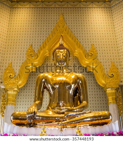 Golden Buddha,Wat Trimit, Bangkok, Thailand. Famous for its gigantic, three-meters tall and 5.5 tons Buddha Image, made of solid gold during the Ayuthaya period. - stock photo