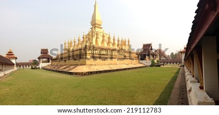 Golden buddhist pagoda of Phra That Luang Temple ; Goegeous Pagoda in Laos ; Vientiane - stock photo