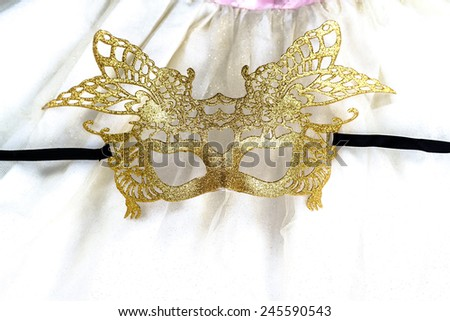 golden carnival mask on dress - stock photo
