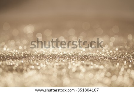 Golden Christmas and New Year bokeh, blinking background with copyspace - stock photo