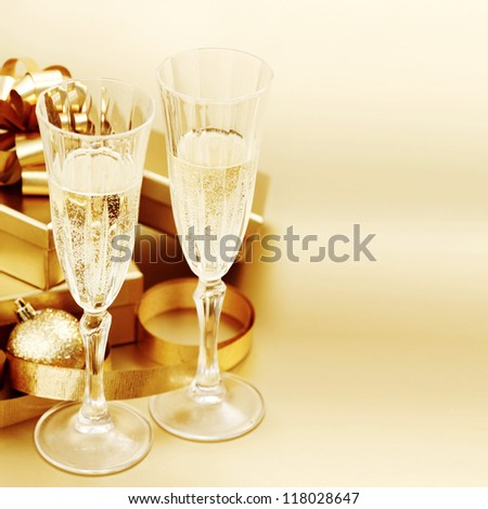 golden christmas background champagne gifts ball - stock photo