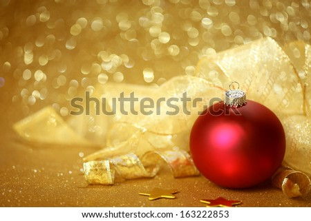 Golden Christmas background with red ornament - stock photo