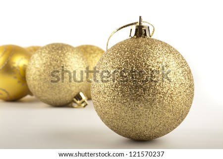 Golden Christmas balls on the table - stock photo