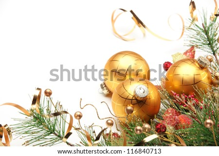 Golden Christmas balls with fir branch on white background. - stock photo