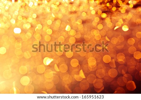 golden christmas lights background - defocused light, warm colors - stock photo