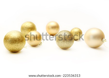 Golden Christmas Ornaments isolated on white  - stock photo