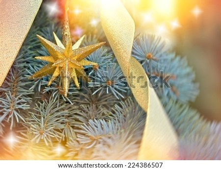Golden Christmas star on Christmas tree - stock photo