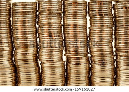 golden coin towers, money background - stock photo