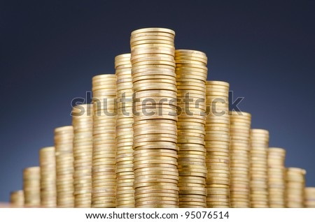 Golden coins in high stacks - stock photo
