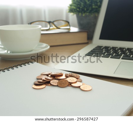 golden coins on office background. finance, business,retirement concept - stock photo
