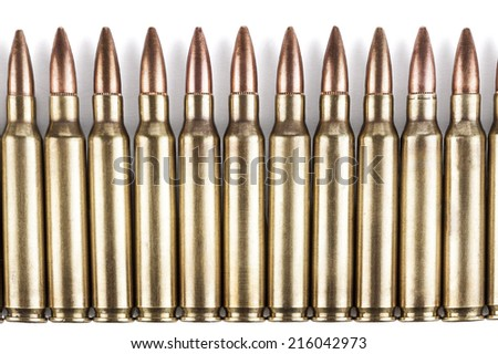 Golden color bullets in a row on white background with shadow - stock photo