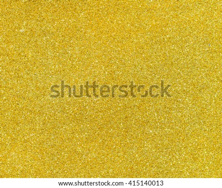 Golden color glitter abstract background texture. - stock photo
