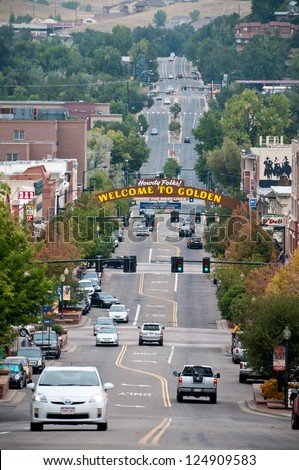 GOLDEN, COLORADO - SEPT. 18: The sign welcoming visitors to historic Golden, Colorado on September 18, 2010.   Founded in 1859 Golden has become a popular tourist destination just outside of Denver - stock photo