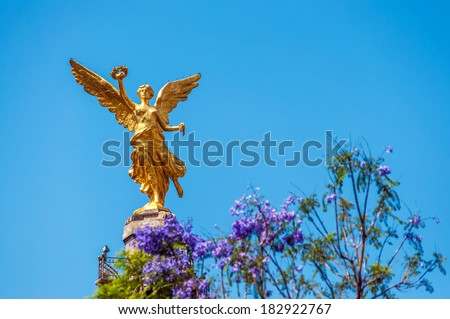 Golden colored Angel of Independence in Mexico City - stock photo
