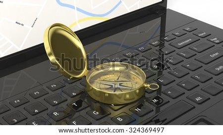 Golden compass on laptop keyboard - stock photo