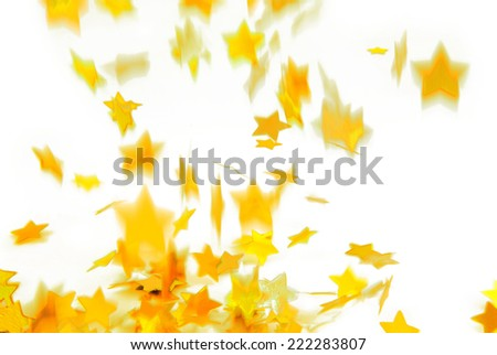 golden confetti  flying isolated on white - stock photo