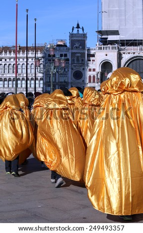 Golden costumes for the Carnival in Venice Italy - stock photo