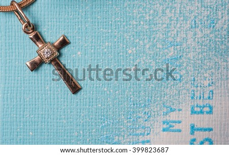 golden cross on a chain - stock photo