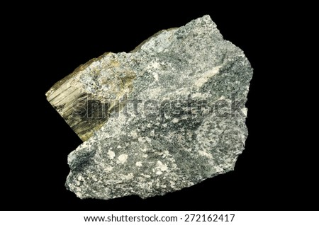 Golden crystal of pyrite on the rock - stock photo