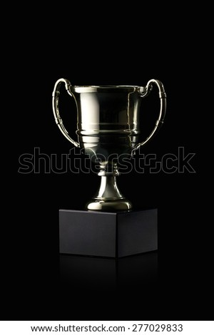 Golden cup of the winner on black background - stock photo