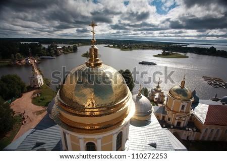 Golden cupola and monastery Nilova Pustyn, Seliger region, Russia - stock photo