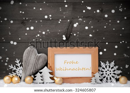 Golden Decoration On Snow. Heart, Christmas Tree Balls, Snowflakes, Christmas Tree.,Picture Frame. German Frohe Weihnachten Mean Merry Christmas. Rustic, Vintage Gray Wooden Background.Black And Withe - stock photo