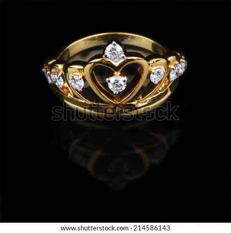 Golden diamond ring on black background - stock photo