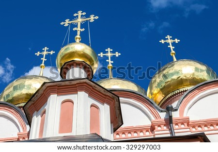 Golden domes of Russian orthodox church in Valday monastery against the dark blue sky - stock photo