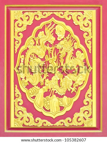 golden dragon decorated on red wood in chinese temple - stock photo