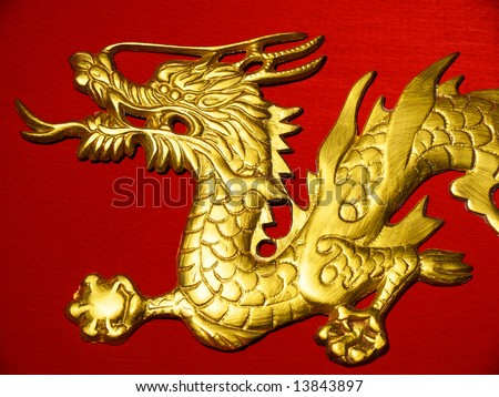 Golden Dragon Head on Red Satin Background - stock photo