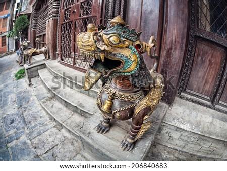 Golden dragon near the monastery near Kathesimbhu stupa in Thamel, Kathmandu, Nepal - stock photo