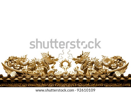 Golden dragon sculpture on the roof isolated on white background - stock photo
