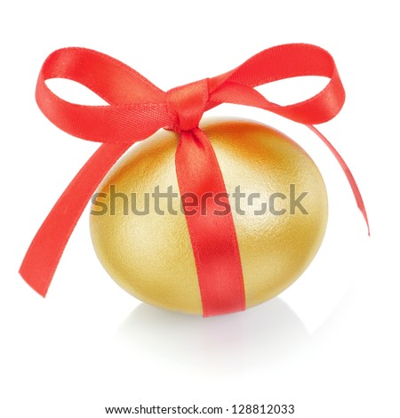 Golden easter egg with red bow. On a white background. - stock photo