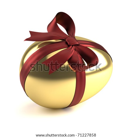 golden easter egg with red ribbon - stock photo