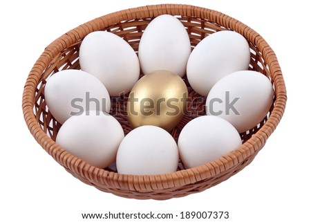 Golden egg and jast eggs in wicker bowl on a white background - stock photo