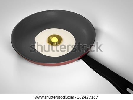 Golden egg in a pan - stock photo