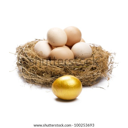 Golden egg in front of normal eggs puted in a nest. Isolated on white. - stock photo