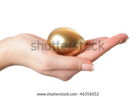 golden egg in the hand - stock photo