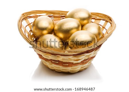 golden eggs in a basket isolated on white background - stock photo