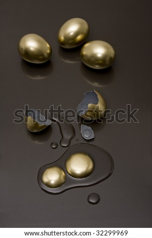Golden eggs with a black background - stock photo